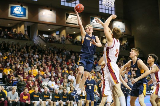 Dylan LeBrun of Augustana goes up for a shot as NSU's Parker Fox defends.