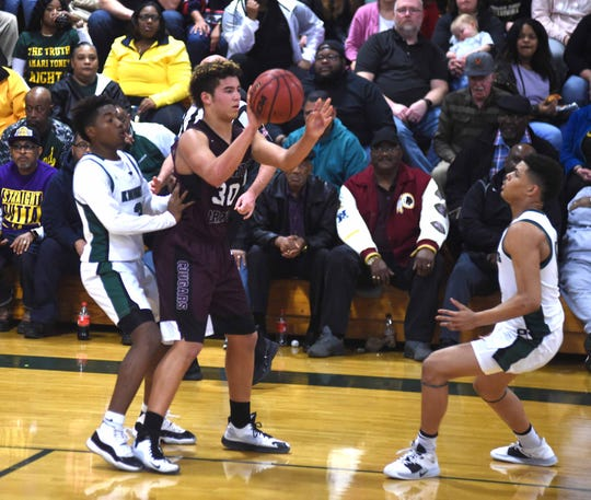Stuarts Draft's Freddie Watkins handles the ball against the Buckingham defense Friday night in the Region 2B boys basketball semifinals. Draft won 89-83.