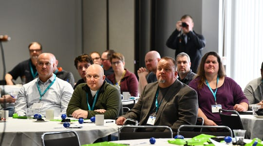 Audience members listen as Gov. Tim Walz speaks during the Minnesota Police and Peace Officers Association annual legislative conference Saturday, Feb. 29, 2019, at the River's Edge Convention Center in St. Cloud.