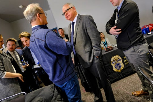 Gov. Tim Walz talks with audience members following his speech at the  Minnesota Police and Peace Officers Association annual legislative conference Saturday, Feb. 29, 2019, at the River's Edge Convention Center in St. Cloud.