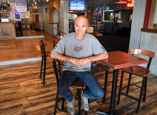 Andy Welsh, owner of the Press Bar, sits in the remodeled upstairs bar area Tuesday, July 31, 2018, along Fifth Avenue in St. Cloud.
