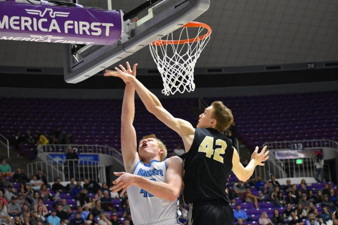 Desert Hills' Keegan Munson contests a shot against a Sky View player during last year's playoffs. The Thunder avenged last year's semifinals loss with a win over the Bobcats in the preseason.