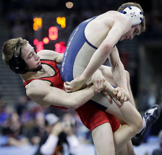 SPASH's Justin Groshek throws Appleton North's Michael Smith in a Division 1 113-pound semifinal match during the WIAA individual state wrestling tournament Friday in Madison.