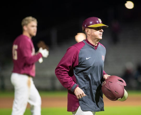 Florida State Seminoles head coach Mike Martin Jr. runs off the field in between innings. The Florida State Seminoles beat the Florida Atlantic Owls 5-1, Friday, Feb. 28, 2020.