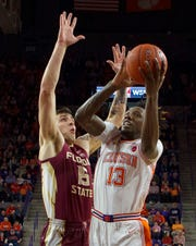 Feb 29, 2020; Clemson, South Carolina, USA; Clemson Tigers forward Tevin Mack (13) shoots the ball while being defended by Florida State Seminoles center Dominik Olejniczak (15) during the first half at Littlejohn Coliseum. Mandatory Credit: Joshua S. Kelly-USA TODAY Sports