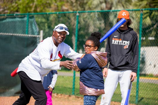 Former MLB star and FAMU legend Vince Coleman teaches a softball player how to hit during MLB's Play Ball outing at Moore-Kittles Field on Saturday, Feb. 29, 2020.