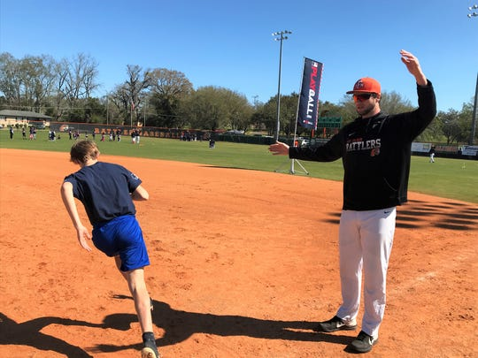 FAMU baseball pitcher Kyle Coleman serves as first base coach during MLB's Play Ball event at Moore Kittles Field on Saturday, Feb. 29, 2020. Kids had a chance to run the bases during a morning filled with baseball activities.