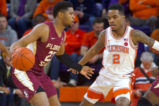 Feb 29, 2020; Clemson, South Carolina, USA; Florida State Seminoles guard M.J. Walker looks to pass the ball while being defended by Clemson Tigers guard Al-Amir Dawes (2)  during the first half at Littlejohn Coliseum. Mandatory Credit: Joshua S. Kelly-USA TODAY Sports