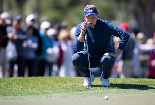 Luke Donald lines up a putt on the 8th hole during the second round of the Honda Classic at PGA National in Palm Beach Gardens, Feb. 28, 2020.