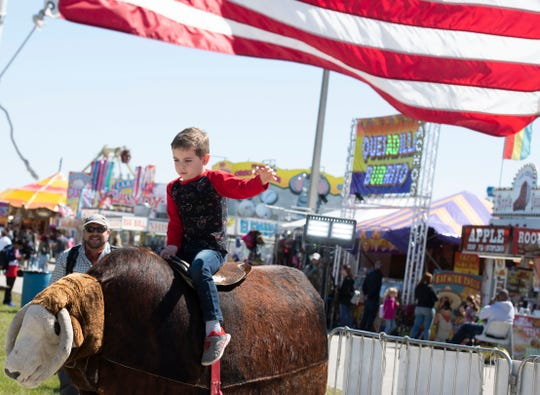 The St. Lucie County Fair ends this weekend at 15601 W. Midway Road, west of Fort Pierce. Wyatt Duplantis, 4, of Fort Pierce, makes an 8-second ride on the Wild Willy World Famous Bucking Bull during the fair on Saturday, Feb. 29, 2020.
