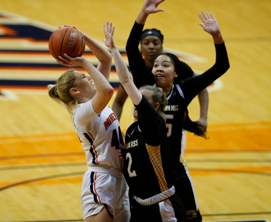 UTEP's Katarina Zec puts up a shot against the defense of Southern Miss' Allie Kennedy Saturday at the Don Haskins Center