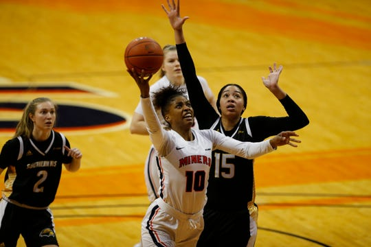 UTEP's Jade Rochelle drives for a basket against the defense of Southern Miss' Amber Landing Saturday at the Don Haskins Center