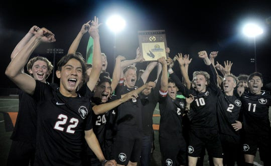 The Foothill Tech boys soccer team holds up the championship plaque after beating Oakwood 4-1 on Friday night at Ventura College to capture the CIF-Southern Section Division 7 championship.
