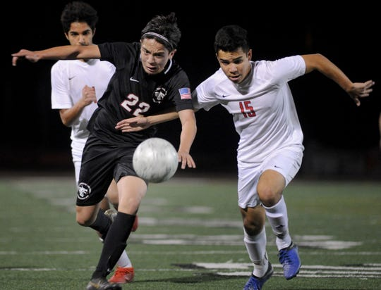 Alex Loza of Foothill Tech, left, fights for the ball against an Oakwood player in the CIF-Southern Section Division 7 championship match at Ventura College Sportsplex. Foothill Tech won, 4-1, for the program's first CIF title.