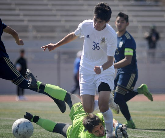 Adrian Martinez of Channel Islands gets past the St. John Bosco goalkeeper during the Raiders' 2-1 overtime win in the CIF-Southern Section Division 2 championship game Saturday at Warren High in Downey. Martinez scored the winning goal in overtime.