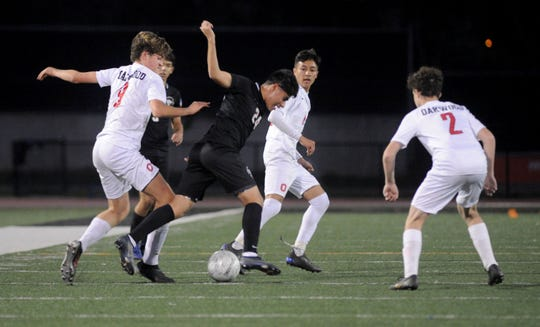 Foothill Tech's Diego Ocampo Garcia (center) is the Division 7 Player of the Year.