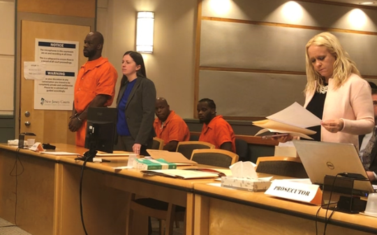 Bridgeton resident Gregory A. Coombs, 41, (left) stands with Public Defender Christine Long at his arraignment hearing on Friday in Cumberland County Superior Court. Long entered a not guilty plea to charges of murder, conspiracy, and burglary. Assistant Prosecutor Cathryn Wilson (right) said a co-defendant is cooperating in the case.