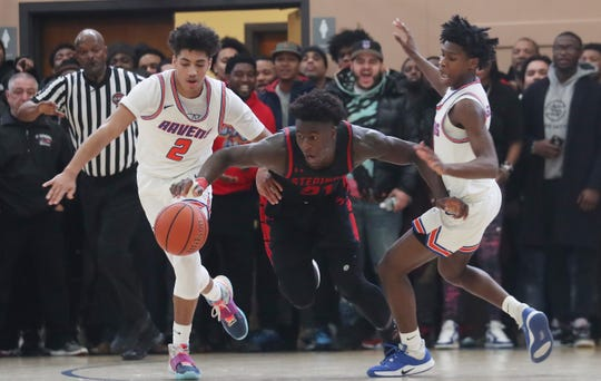 Stepinac's Adrian Griffin Jr  (21) gets between St. Ray's Luis Kortright (2) and Reginald Hudson (3) during action in the CHSAA_NYC title at Mount Saint Michael Academy Feb. 29, 2020. Stepinac won the game 73-68.