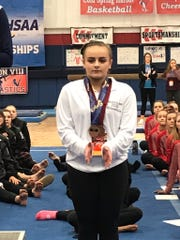 Putnam Valley's Caitlin Pellegrino finished sixth in the vault at the state championships at Cold Spring Harbor High School on Feb. 29, 2020.