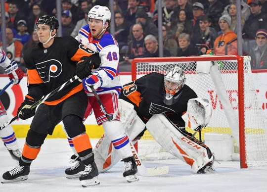 Feb 28, 2020; Philadelphia, Pennsylvania, USA; Philadelphia Flyers defenseman Travis Sanheim (6) and New York Rangers left wing Brendan Lemieux (48) battle for position in front of Philadelphia goaltender Carter Hart (79) during the first period at Wells Fargo Center. Mandatory Credit: Eric Hartline-USA TODAY Sports
