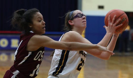 Lourdes'  Sofia Feigelson is pressured by Ossining's Courtney See during their playoff game at Lourdes Feb. 28, 2020. Lourdes won 63-56.