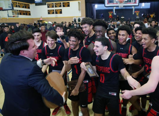 From left, Stepinac coach Pat Masaroni celebrates with his team after defeating St. Raymond  73-68 in the CHSAA_NYC title at Mount Saint Michael Academy Feb. 29, 2020.