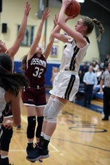 Ava Learn shoots over the Ossining defense during Lourdes' 63-56 victory in the Class A quarterfinal at Lourdes on Feb. 28, 2020.