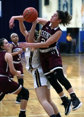 Lourdes' Gabby Campilii fights for the ball with Ossining's Julia Iorio, right, during their playoff game at Lourdes Feb. 28, 2020. Lourdes won 63-56.