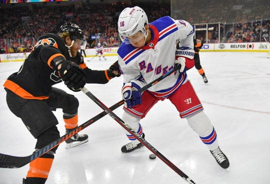 Feb 28, 2020; Philadelphia, Pennsylvania, USA; New York Rangers center Ryan Strome (16) and Philadelphia Flyers right wing Jakub Voracek (93) battle for the puck during the first period at Wells Fargo Center. Mandatory Credit: Eric Hartline-USA TODAY Sports