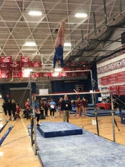 Putnam Valley's Caitlin Pellegrino on the uneven bars at the state championships at Cold Spring Harbor High School on Feb. 29, 2020.