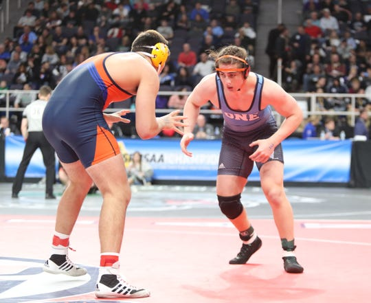 White Plain's Sebastian Garibaldi  wrestles in a 220-pound semifinal match at the NYSPHSAA Wrestling Championships at Times-Union Center in Albany on Saturday, February 29, 2020.