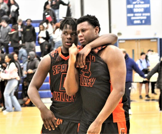 Colby Adrien (l) tries to console Spring Valley teammate Jaylen Floyd (r) after Suffern defeated the Tigers in the Class AA quarterfinals Feb. 28, 2020.