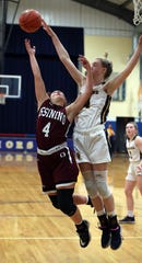 Lourdes'  Ava Learn blocks a shot by Ossining's Brooke Weeks during their playoff game at Lourdes Feb. 28, 2020. Lourdes won 63-56.