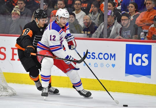 Feb 28, 2020; Philadelphia, Pennsylvania, USA; New York Rangers right wing Julien Gauthier (12) controls the puck against Philadelphia Flyers defenseman Robert Hagg (8) during the first period at Wells Fargo Center. Mandatory Credit: Eric Hartline-USA TODAY Sports
