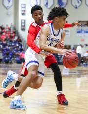 Dover's Elijah Allen (5) is finding it difficult to continue basketball workouts with all of the state's gyms closed.