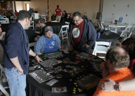 A group plays a tabletop board game Saturday, Feb. 29, 2020, at Fallscon held at the French Country Meadow in Wichita Falls.