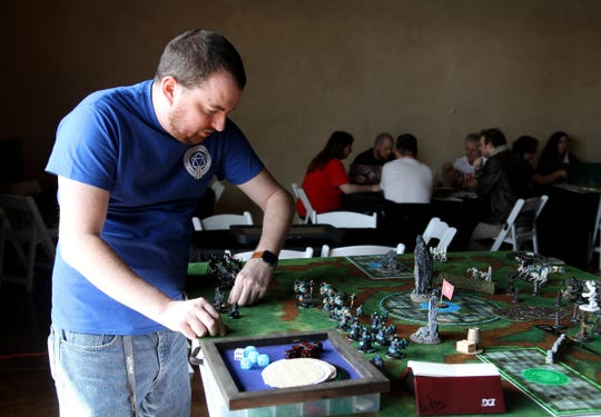 John Haas makes his first move while playing Warmachine and Hordes Saturday, Feb. 29, 2020, at Fallscon held at the French Country Meadow in Wichita Falls.