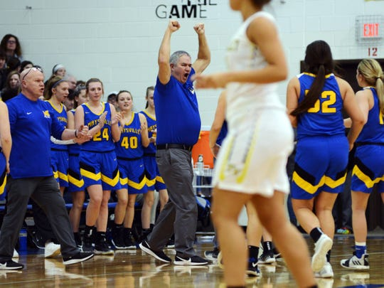 Maysville assistant coach Troy Vallee celebrates after Tri-Valley called timeout in the fourth quarter of their Division II district final at West Muskingum's Gary Ankrum Gymnasium.