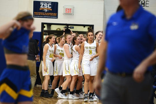 Tri-Valley's bench celebrates following a 44-41 win against Maysville in a Division II district final at West Muskingum's Gary Ankrum Gymnasium.