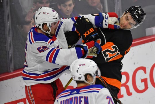Feb. 28: New York Rangers defenseman Ryan Lindgren and Philadelphia Flyers center Scott Laughton get roughing penalties during the third period at Wells Fargo Center.