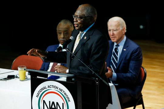 Democratic presidential candidate former Vice President Joe Biden, right, and The Rev. Al Sharpton, left, listen to Rep. James Clyburn, D-S.C., speak Feb. 26, at the National Action Network South Carolina Ministers' Breakfast, (AP Photo/Matt Rourke)