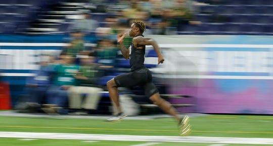 Alabama wide receiver Henry Ruggs III runs the 40-yard dash.