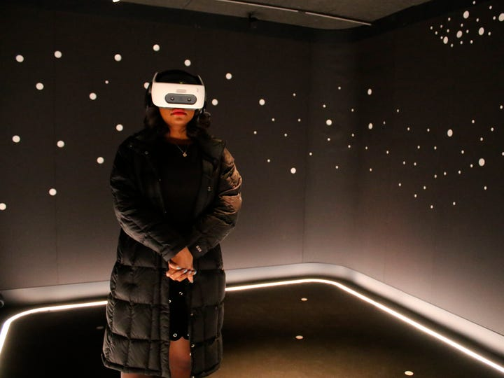 """In this Wednesday, Feb. 26, 2020 photo, a visitor experiences """"The March"""" virtual reality exhibit at the DuSable Museum of African American History in Chicago ahead of the project's launch. The exhibit captures the 1963 March on Washington during which Martin Luther King Jr. delivered his famous 'I Have a Dream' speech."""