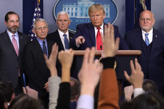 President Donald Trump takes questions as Health and Human Services Secretary Alex Azar, National Institute for Allergy and Infectious Diseases Director Anthony Fauci, Vice President Mike Pence, and Centers for Disease Control and Prevention Director Robert Redfield look on during a news conference at the White House February 29, 2020, in Washington.