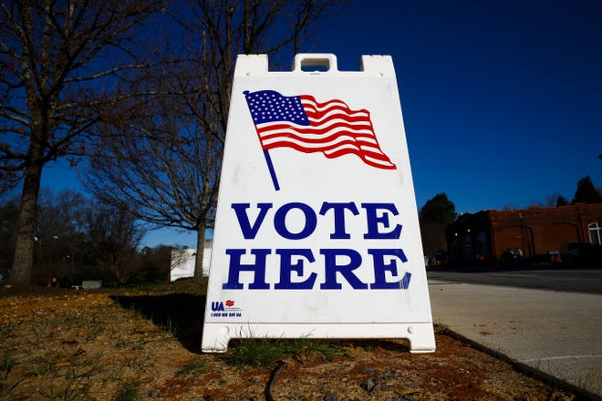 A vote here sign is seen outside a polling place during the South Carolina primary.