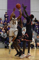 LSUA's Carlos Coleman (24) tries to get a pass off against University of the Southwest Saturday. The Generals won 87-77.