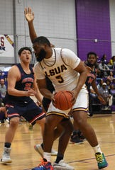 LSUA senior Trent Brinkley (5) tries to score inside against the University of the Southwest Saturday.