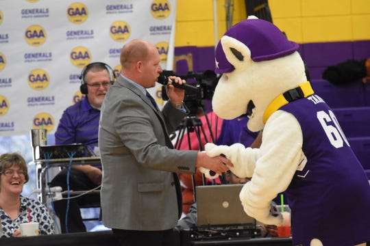 Adam Jonson, athletic director at LSUA, shakes hands with Tank, the LSUA mascot. LSUA recently recognized its faculty and staff with an online celebration.