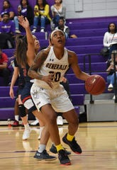 LSUA senior Kendriana Washington (20) goes up in the post against the University of the Southwest Saturday. The Lady Generals won 93-84.