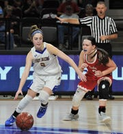 Zoe Bratcher, left, drives around Hermleigh's Brittany Smith in the fourth quarter. Veribest won the Region II-1A championship game 27-25 on Saturday, Feb. 29, 2020, at ACU's Moody Coliseum.